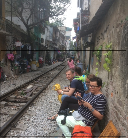 excited to drink beer and egg coffe beside railway